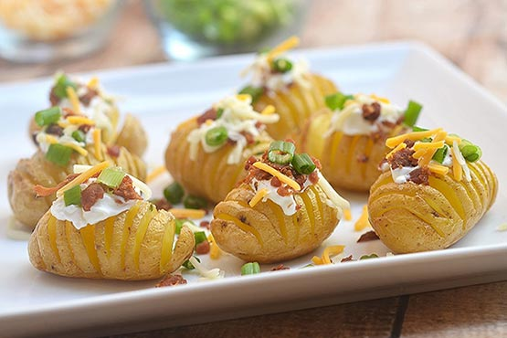 Hasselback potatoes recipes . Mini Loaded Hasselback Potatoes