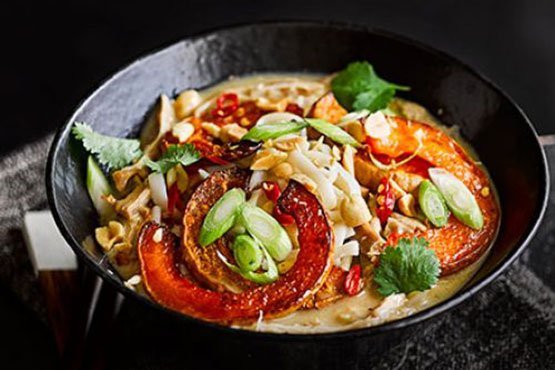 Comfort food recipes . Satay chicken noodle soup with squash