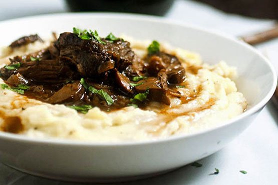 Comfort food recipes . wine braised short ribs and creamy white cheddar mashed potatoes