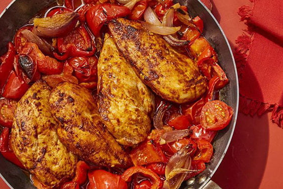 Easy chicken dinner ideas . Chicken with Stewed Peppers and Tomatoes