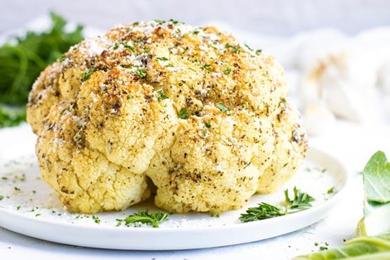 Roasted cauliflower recipes . Garlic & Herb Whole Roasted Cauliflower