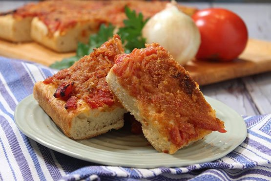 Sicilian pizza recipes . Sicilian Pizza Topped with Tomatoes and Onions