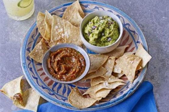 Homemade tortilla chips with guacamole & charred tomato salsa
